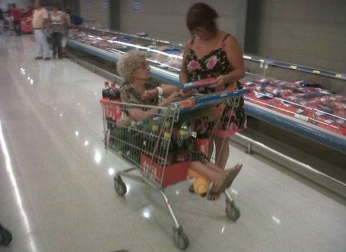 Picture of grandma buried in a shopping cart by soda pop.